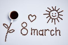 Flower, the sun, a heart and the inscription made from coffee beans. stock photos