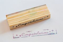 Congratulation stamped on paper Stock Image