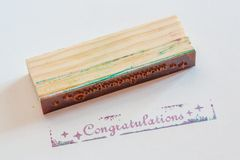 Congratulation stamped on paper Royalty Free Stock Image