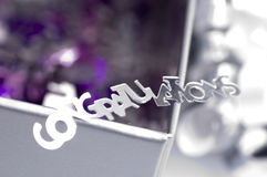 Congratulations. Confetti spelling congratulations against a purple box Royalty Free Stock Images