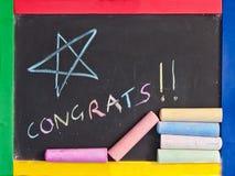 Congratulations. Written on a blackbaord Stock Image