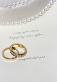 Congratulations. Wedding bands on white background with pearls and letters saying congratulations Stock Photos