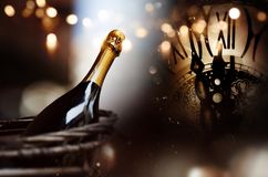 Congratulations with a bottle champagne and clock for new year. Congratulations with a bottle champagne and clock for a happy new year background Royalty Free Stock Photo