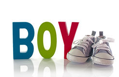 Congratulations with a boy card with small sport shoes Stock Images