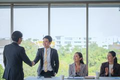 Congratulations business, Group business meetings begin work on. The creation and talked about plans for a new project in the office royalty free stock photo