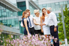 Congratulations in business team with handshake Royalty Free Stock Photos