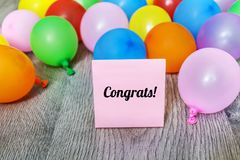 Greeting Card with Balloons and Congrats Message Stock Image