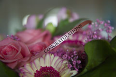Congratulations. Flower bouquet with ribbon saying congratulations Stock Photo
