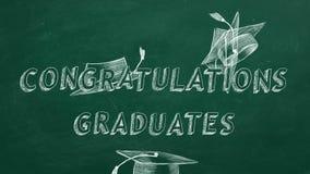 Congratulations graduates. Hand drawing text `Congratulations graduates` and graduation caps  on green chalkboard