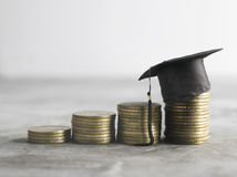 Congratulations graduates on top of the money scholarship money. Background concept Stock Photo