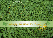 Congratulations with Happy St. Patrick`s Day on background of clover Stock Images