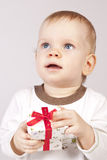 Congratulations on a holiday!. Boy with a small gift box congratulate on the holiday Royalty Free Stock Photography