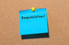 Congratulations - inscription on blue sticker pinned to cork notice board. With empty space for text.  Royalty Free Stock Photos
