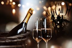 Congratulations for new year with champagne and clock. Background for new year congratulations with champagne and a clock stock photo