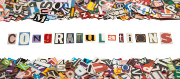 Congratulations - Newspaper Text. A title Congratulations made of newspaper letters surrounding by other letters against a white background Stock Photos