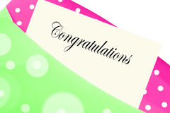 Congratulations note or letter. In pink and green polkadot envelope Stock Image