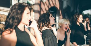 Congratulations for pretty women team concept. Compliments by phone. happy moments Royalty Free Stock Photography