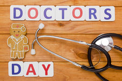 Congratulations to Doctor Day. Biscuits in the form of a man, a doctor by profession Stock Photo