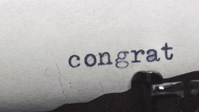 Congratulations - Typed on an old vintage typewriter. Close-up stock video