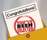 Congratulations You've Been Selected Stamp Official Letter. Congratulations You've Been Selected words on an official letter or notification in an envelope to a Stock Photo