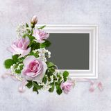 Congratulatory background with frame and bouquet of roses on vintage background Stock Photos