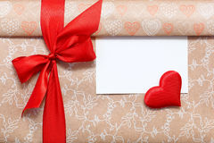 Congratulatory background. A gift box tied with a red ribbon. Stock Images