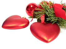 Congratulatory Christmas red balls and hearts on a fur-tree?s br. Anch Royalty Free Stock Photo