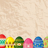 Congratulatory Easter card with old paper background and eggs Stock Photo