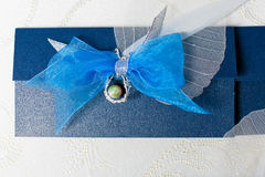 Congratulatory envelope with a bow. Color blue, and tied a ribbon bow. An envelope for presenting a gift of money, the wedding tradition monetary Royalty Free Stock Images