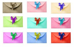 Congratulatory envelope with a bow. Different colors. Nine envelopes - allocated on a white background. Color: yellow, green, red, pink, turquoise, blue, and Stock Photos
