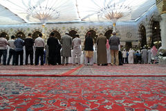 The congregation prayed Muslims Nabawi Mosque, Medina, Saudi Ara. MEDINA, KINGDOM OF SAUDI ARABIA (KSA) - JAN 31: Muslims praying in Masjid Nabawi on January 31 Stock Image