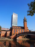 Congregational Church in Castlefield, Manchester UK. Congregational Church and canals in Castlefield, Manchester, with the backdrop of Beetham Tower royalty free stock images