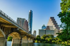 Congress Avenue Bats Bridge and skyscrapers in Austin TX. Austin, Texas - June 1, 2014: Skyscrapers and the Ann W. Richards Congress Avenue Bridge bats bridge Stock Images
