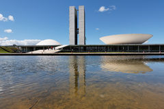 Congress in Brasilia Capital of Brazil. The facade of the congress building in Brasilia, capital of Brazil reflected on the waters of a lake with its two towers Stock Images