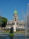 Congress Building Buenos Aires. Pedestrians, a fountain with a dark sculpture and the facade of the Congress  Building with its green copper dome Stock Images