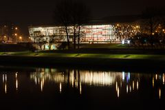 Congress Hall Ice. Krakow, Poland, November 02 2014: Night view of Congress Hall Ice with reflections in Vistula river Royalty Free Stock Photo