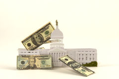 Congressional Spending. US Congress building with American dollar bills floating by stock photography