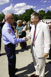 Congressman Kissel Shaking Hands with EMT. North Carolina Congressman Larry Kissel shaking hands and thanking a local EMT First Responder for their service after Royalty Free Stock Photo