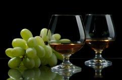 Conhaque e uvas Fotografia de Stock Royalty Free