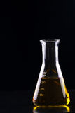 Conical flask filled with yellow chemical - Series 4 Stock Photo