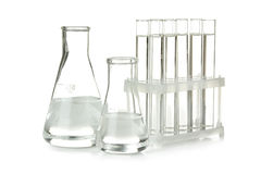 Conical flask and glass test-tubes. Conical flask and  glass test-tubes in the support on isolated background Royalty Free Stock Photography
