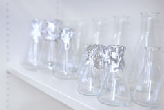 Conical flasks, shelf of clean laboratory glassware stock images