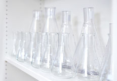 Conical flasks, shelf of clean laboratory glassware royalty free stock image