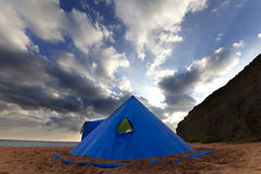 Conical tent on summer beach in evening Stock Image