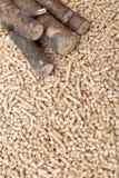 Coniferous biomass - renewable materials. Coniferous biomass - pellets and wood, renewable energy royalty free stock image