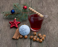 Coniferous branch with Christmas tree decorations, tea, a star, Royalty Free Stock Photo