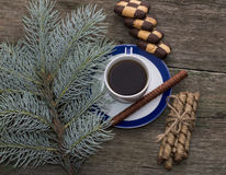 Coniferous branch, coffee and cookies top view Stock Photos