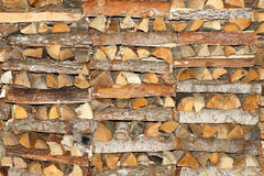 Coniferous and deciduous wood stacked in a pile Royalty Free Stock Image