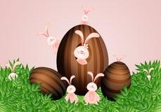 Conigli con le uova di Pasqua del cioccolato Immagini Stock Libere da Diritti