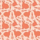 Conigli e carote su un fondo rosa illustrazione di stock